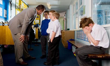 Teacher lecturing boys